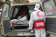 Yemen Red Crescent personnel unload a body from an ambulance at Amran Hospital. The ICRC is providing the Yemen Red Crescent with body bags and first-aid kits to help them respond to the emergency.
