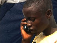 Ivorian boy passing a phone call