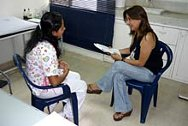 Myriam Ortiz interviewing a nurse at the main hospital of Puerto Asís, Putumayo.