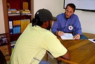 Eros Bosisio interviewing a displaced person at the ICRC office in Florencia.