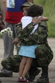 March 2010. Sergeant Moncayo's little sister welcomes him on his release from 12 years in captivity.