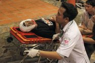Paramedics rush a casualty of clashes between Thai soldiers and anti-government protesters to an ambulance.