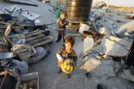 Children living in the ruins of what was once their house in Gaza.