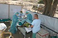 Djebel Mara region, Sudan. A medical group based in Nyala performs an emergency operation in a field clinic.