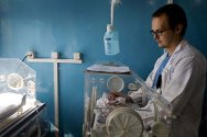 Christian Shuh attends to a premature baby at the paediatric unit of the Mirwais Hospital in Kandahar.