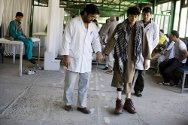 ICRC rehabilitation centre, Kabul. A boy learns to walk on his new artificial legs.