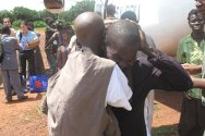 Central African Republic. Jacques and his father Jean-Paul's emotional reunion at Obo airstrip.