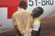 Central African Republic. Another boy brought home to his family in Obo is joyfully embraced by his elder brother.