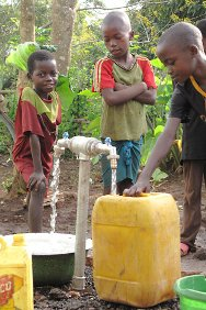 Central African Republic. Children collect water using the emergency water system set up by the ICRC.