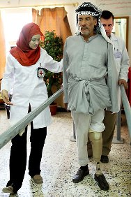 Al Sadr hospital, Najaf. An amputee at a physical rehabilitation session.
