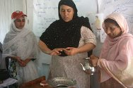 Anjum, a PRCS volunteer in Pakistan-administered-Kashmir, gives a briefing on hygiene.