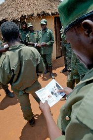 Minembwe, South Kivu. A Congolese army officer reading an ICRC brochure during a meeting to promote compliance with international humanitarian law.