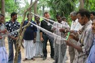 Batticaloa district. Beneficiaries of a fishery project receiving training on how to maintain fishing nets.