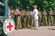 Trincomalee district, Mutur village. An ICRC delegate distributes brochures to police officers attending a dissemination session on international humanitarian law.