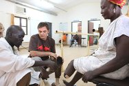 Juba, South Sudan. Apai Marceline, a refugee from the Democratic Republic of Congo, talks with ICRC physiotherapists Yvan Sieler and Duku Simon about her new prosthesis.