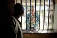 Masvingo, Zimbabwe. A prisoner receives a visit from his wife.