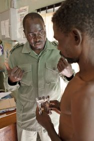 Zimbabwe. The Nurse in Charge at Masvingo Remand Prison explains to a malnourished prisoner the treatment he will have to follow until he recovers.