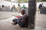 Masvingo, Zimbabwe. Prisoners eat their lunch in the yard of Masvingo Remand Prison.