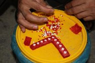 Beadwork requires patience and concentration, and can occupy the men for hours