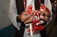 The men sell their beaded flowers, costume jewellery and other trinkets to prison visitors