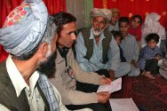 In a village near Kunduz, in northern Afghanistan, a Red Cross message is received by the family of a detainee.
