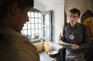 Kandahar, central prison. An ICRC delegate talks to a security detainee in the juvenile section.