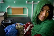 Mirwais hospital, Kandahar. Paediatric unit. A woman sits with her child, who is suffering from severe diarrhoeah.