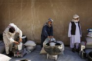 Mirwais Hospital, Kandahar. Men receive rice, oil, animal feed and a milk churn as part of an ICRC agricultural project.