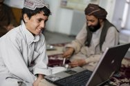 ICRC office, Kandahar. Relatives talk to a detainee via a video telephone link.