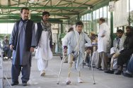 Kabul, ICRC orthopaedic centre. A boy practises walking with his prostheses.