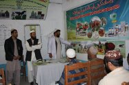 Etehad Agricultural and Livestock Cooperative, Kandahar, Afghanistan. Dr Allakozai illustrates his lesson using pictures and charts.