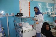 Mirwais Regional Hospital, Kandahar. A nurse monitors the condition of a baby in an incubator, one of several on the ward.