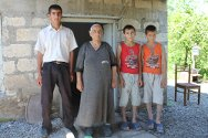 Gaziyan, Terter, Azerbaijan. Life is much easier for these schoolboys and their grandmother now that they have a tapstand in front of their house.