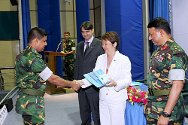 A member of the Bangladeshi armed forces receives his certificate of participation from Judy Cheng-Hopkins at the conclusion of the five-day IHL train-the-trainer course.