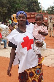 Agoumar, Central African Republic. Denise in her new Red Cross volunteer outfit, holding her baby girl.