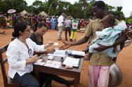 Obo, region of Haut-Mbomou, Central African Republic. Central African Red Cross Society volunteers help distribute relief goods at a camp for internally displaced persons outside the town.
