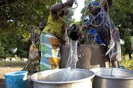 Ouham province, CAR. Women draw water from a well repaired by the ICRC.