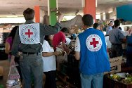 Colombian Red Cross depot in Bogotá. Staff prepare emergency packages made possible by private donations.