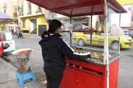 Sandra at her hot-dog stand. She sees her new trade not only as a means of earning a living, but also as a form of therapy.
