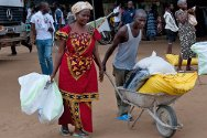 Local branch of the Red Cross Society of Côte d'Ivoire, Yopougon, Abidjan, Côte d'Ivoire. A man and a women leave with a consignment of food and basic supplies.
