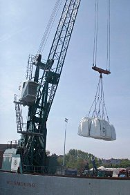 Sacks of lime for water purification are loaded aboard the Oslo Bulk 3, en route to Côte d'Ivoire.