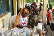 Toulepleu, Côte d'Ivoire. The mobile clinic's medical team providing consultations and treatment at the offices of the local Ivorian Red Cross.