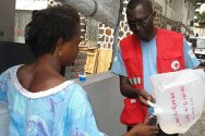 Abidjan. An Ivorian Red Cross volunteer hands out water.