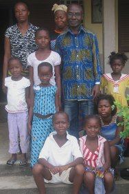 Laurent Dadie surrounded by his family at the Notre Dame church in Abidjan.