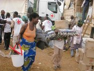 Catholic mission, Duékoué, Côte d'Ivoire. A woman carries away a consignment of ICRC relief goods with the help of an Ivorian Red Cross volunteer.