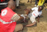 Abidjan. An Ivorian Red Cross volunteer providing first aid to an injured man at the scene of the violence.