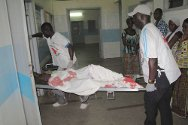 Abidjan. Ivorian Red Cross volunteers arrive at hospital with a victim of the violence.