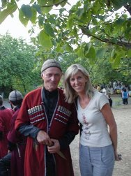 Ariane Tombet with a folk singer in Tbilisi