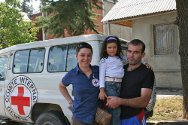 South Ossetia. An ICRC delegate with a newly-reunited family.