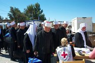 Keneitra crossing point. ICRC staff register Druze pilgrims making the trip from the occupied Golan into Syria proper.